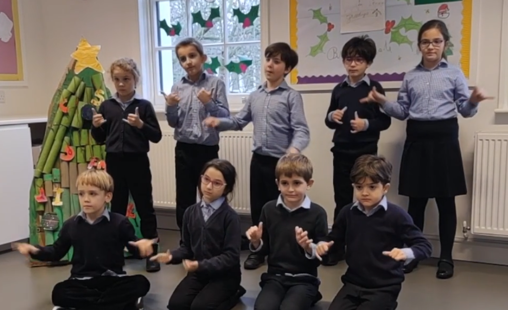 Watch our students sign singing some of the most famous Christmas songs